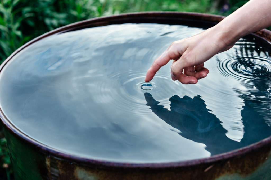 Closeup of a woman's hand touching water